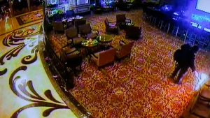 Police authorities and Resorts World Manila complex security play a CCTV video of the gunman setting a fire in the casino after storming the complex during a news conference on Saturday, June 3, 2017, in Pasay city, southeast of Manila, Philippines. Police say a gunman stormed the crowded casino resort and used gasoline to set gambling tables on fire, creating clouds of smoke that swept through the crowds and killed dozens of people. (Bullit Marquez/AP Photo)