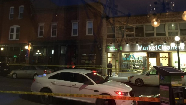 Police car is parked in the Byward Market following possible shooting