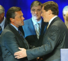 Leadership candidate Frank Klees congratulates John Tory after Tory was announced as the new leader of the Ontario PC party in Toronto, Saturday, Sept. 18, 2004. Klees is again seeking the Ontario PC leadership. (Adrian Wyld / THE CANADIAN PRESS)
