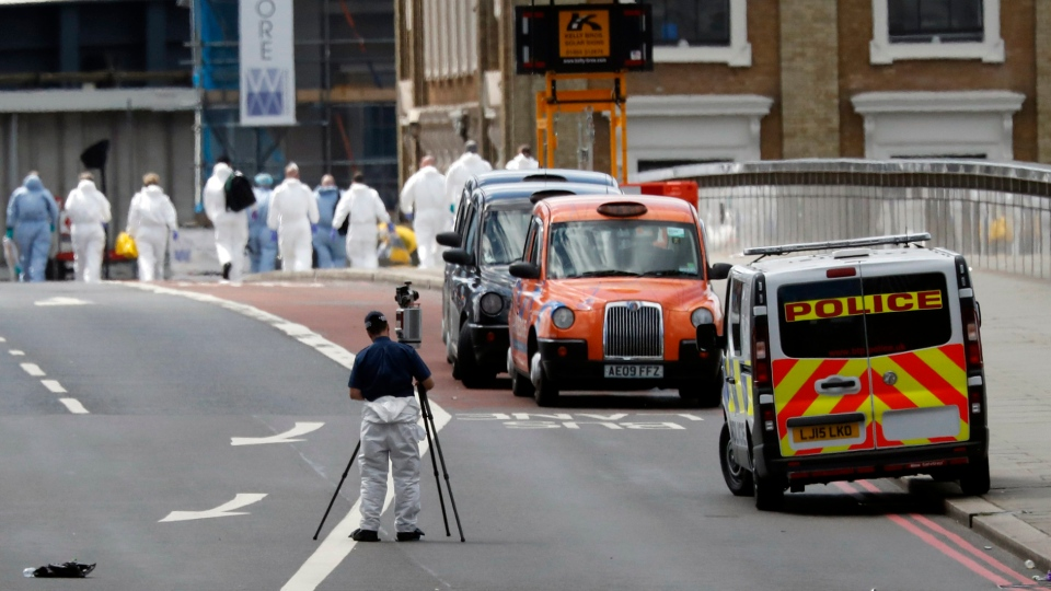 Forensic police work within a cordoned off area after an attack in the London Bridge area of London, Sunday, June 4, 2017. (AP Photo/Frank Augstein)