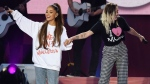 In this Sunday, June 4, 2017, handout photo provided by Dave Hogan for One Love Manchester, singers Ariana Grande, left, and Miley Cyrus perform at the One Love Manchester tribute concert in Manchester, north western England. One Love Manchester is raising money for those affected by the bombing at the end of Ariana Grande's concert in Manchester on May 22, 2017. (Dave Hogan / AP)