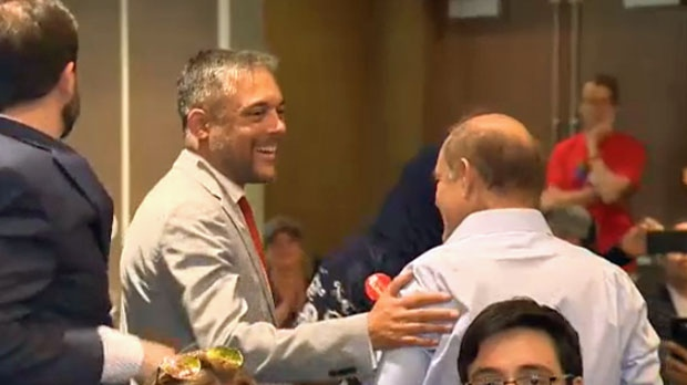 David Khan is congratulated by supporters after being selected as the leader of the Alberta Liberal Party