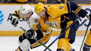 Nashville Predators defenseman Ryan Ellis (4) and Pittsburgh Penguins center Sidney Crosby (87) battle for the puck during the second period in Game 3 of the NHL hockey Stanley Cup Finals Saturday, June 3, 2017, in Nashville, Tenn. (Mark Humphrey/AP)