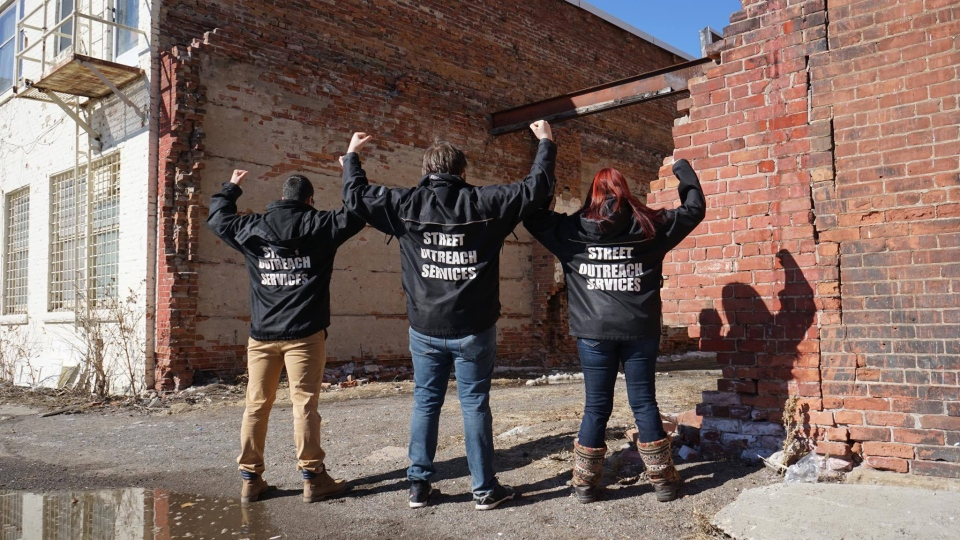 Shelter House;s Street Outreach Services' members pose for a photo wearing matching jackets. (Alexandra Calderon)