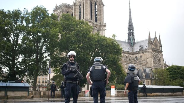 Paris attacker shot by police as tourist area locked down
