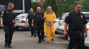 Lee Donald Kaplan, front in yellow, and Daniel Stoltzfus, back in yellow, are led to a preliminary hearing outside Bucks County Magisterial District in Feasterville, Pa. on Aug. 2, 2016. (AP / Megan Trimble)