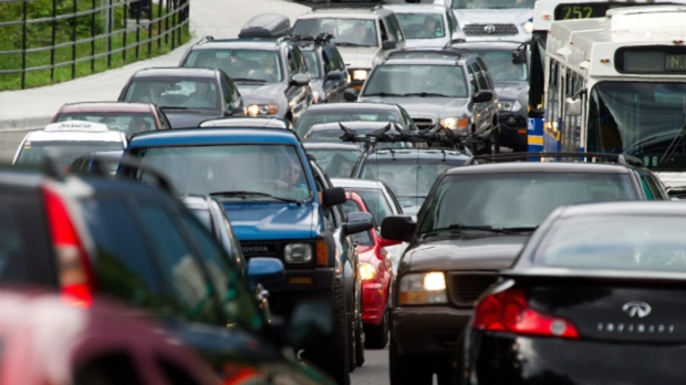 Motorists merge from four lanes into one as they enter the Lions Gate Bridge to drive into Vancouver, B.C., on Friday, July 15, 2011. (Darryl Dyck / THE CANADIAN PRESS)
