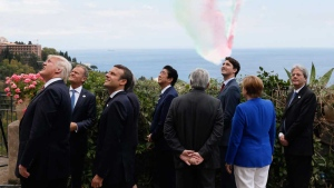 From left, U.S. President Donald Trump, European Council President Donald Tusk, British Prime Minister Theresa May, French President Emmanuel Macron, Japanese Prime Minister Shinzo Abe, European Commission President Jean-Claude Juncker, Canadian Prime Minister Justin Trudeau, German Chancellor Angela Merkel and Italian Prime Minister Paolo Gentiloni watch an Italian flying squadron as part of activities at the G7 Summit in Taormina, Sicily, Italy, Friday, May 26, 2017. (Jonathan Ernst/Pool Photo via AP)