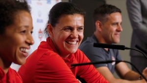 From left, team Canada soccer players Desiree Scott, Christine Sinclair and coach John Herdman speak to media in Winnipeg, Tuesday, June 6, 2017 (John Woods/THE CANADIAN PRESS)