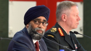 Defence Minister Harjit Sajjan unveils the Liberal government's long-awaited vision for expanding the Canadian Armed Forces in Ottawa on Wednesday June 7, 2017. Canada will increase defence spending by $13.9 billion over the next decade. The Chief of the Defence Staff Jonathan Vance looks on. THE CANADIAN PRESS/Adrian Wyld