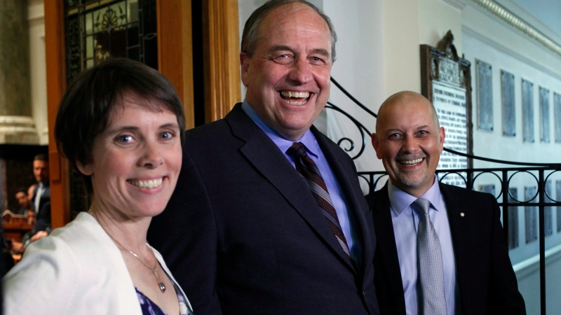B.C. Green Caucus elected MLA's Sonia Furstenau, Andrew Weaver and Adam Olsen wait outside the legislative assembly before officially being sworn in as members during a ceremony at Legislature in Victoria, B.C., on Wednesday, June 7, 2017. (Chad Hipolito/The Canadian Press)