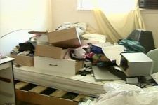 Owners of this raided house aren't happy with what remains following the police operation on Wednesday, June 13, 2007.