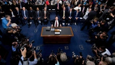 James Comey takes his seat to testify