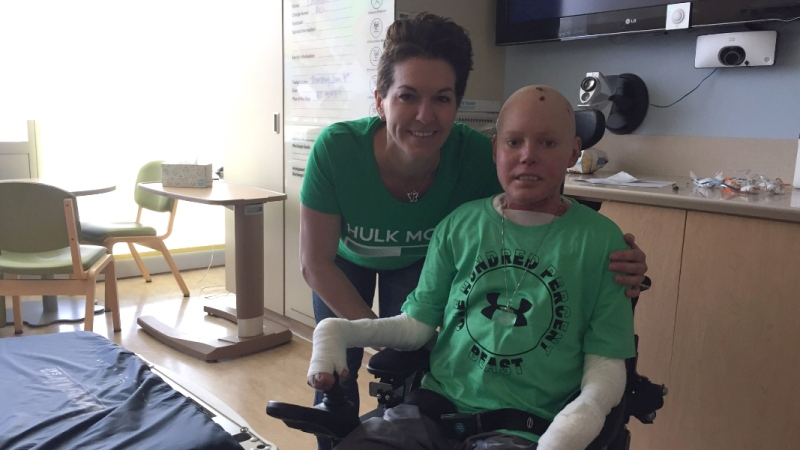 Tina Boileau is seen with her son, Jonathan Pitre, in a Minneapolis hospital. (Twitter: Tina Boileau)