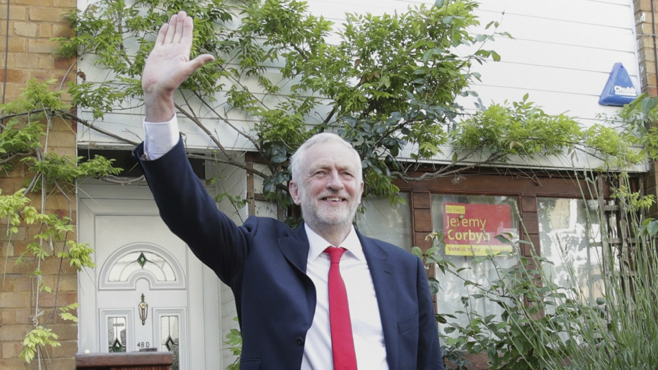 Labour leader Jeremy Corbyn waves as he leaves his home in north London on Friday June 9, 2017. (Yui Mok / PA)