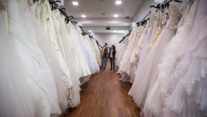 Women browse wedding dresses for sale at the Original Bridal Swap at the Croatian Cultural Centre in Vancouver, B.C., on Sunday April 3, 2016. Most modern couples seem more eager to break the wedding 'rules' than follow them. (THE CANADIAN PRESS/Darryl Dyck)