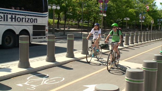 Cyclists take the new MacKenzie Avenue bike Lane for a spin on June 9, 1017.