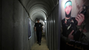 In this July 20, 2016 file photo, a Palestinian youth walks inside a tunnel used for military exercises during a weapon exhibition at a Hamas-run youth summer camp, in Gaza City. (AP Photo/Adel Hana, File)