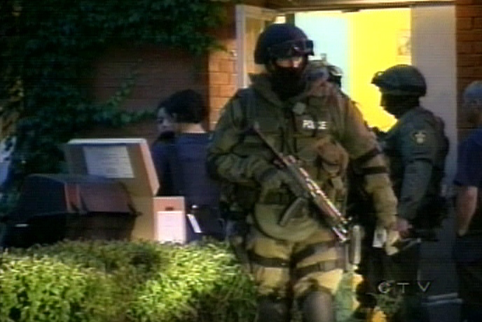 Heavily armed OPP officers conduct the early morning raid in a region of North York on Wednesday, June 13, 2007.