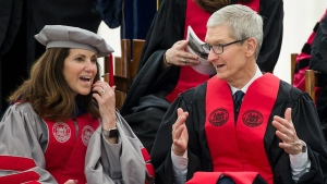 Apple CEO Tim Cook, right, chats with MIT Chancellor Cynthia Barnhart during the commencement exercises at the Massachusetts Institute of Technology Friday, June 9, 2017, in Cambridge, Mass. (Dominick Reuter/MIT via AP)