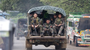 Soldiers ride a military vehicle on the outskirts of Marawi city, southern Philippines on June 9, 2017. (AP / Aaron Favila)