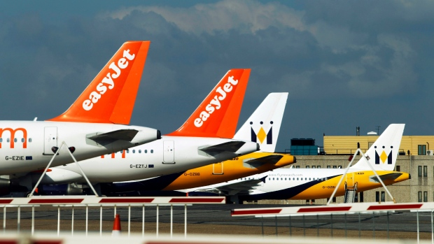 EasyJet planes stand on the tarmac of Luton Airport in Luton, England Thursday on April 15, 2010. (Matt Dunham/AP Photo)
