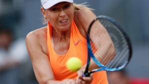 In this May 8, 2017, file photo, Maria Sharapova hits a return to Eugenie Bouchard, of Canada, during a Madrid Open tennis tournament match in Madrid, Spain. (AP Photo / Francisco Seco, File)