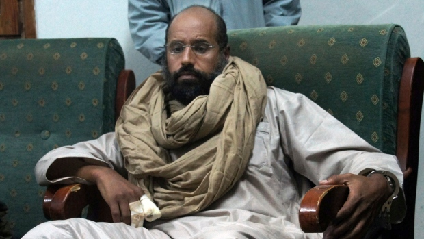 In this Nov. 19, 2011, file photo, Seif al-Islam is seen after his capture in the custody of revolutionary fighters in Zintan, a town south of the capital Tripoli, Libya. (AP Photo / Ammar El-Darwish, File)