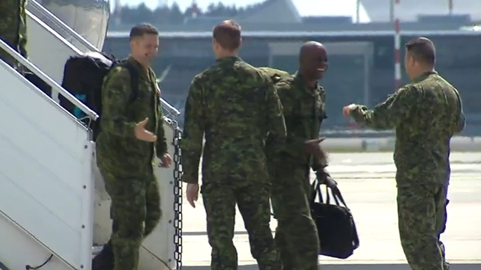 Canadian troops are seen arriving in Latvia on Saturday, June 10, 2017.