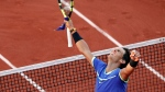 Spain's Rafael Nadal celebrates winning against Austria's Dominic Thiem during their semifinal match of the French Open tennis tournament at the Roland Garros stadium, in Paris, France, Friday, June 9, 2017. (AP Photo/Christophe Ena)
