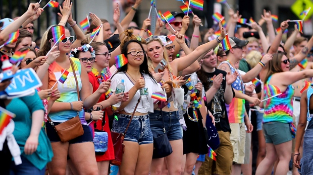 Spectators line the sidewalk on Beacon Street during the annual Pride Day Parade in front of the State House in Boston on Saturday, June 10, 2017. (John Tlumacki/The Boston Globe via AP)