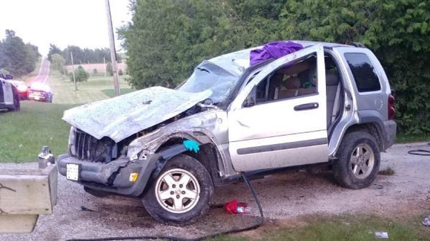 Police said an SUV lost control and crashed ejecting one person and trapping another inside the vehicle. (Source: OPP)
