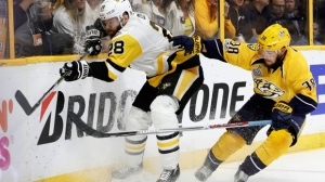 Nashville Predators' Viktor Arvidsson (38), of Sweden, checks Pittsburgh Penguins' Ian Cole (28) into the boards during the third period of Game 6 of the NHL hockey Stanley Cup Final, Sunday, June 11, 2017, in Nashville, Tenn. (AP Photo/Mark Humphrey)