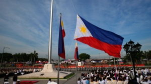 The Philippine flag is raised to celebrate the 119th anniversary of Philippine independence at Manila's Rizal Park Monday June 12, 2017 in Manila, Philippines.(AP Photo/Bullit Marquez)