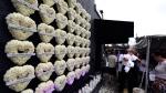 A wall of flowered-hearts on the side of the Pulse nightclub, on June 12, 2017. (Joe Burbank /Orlando Sentinel via AP)