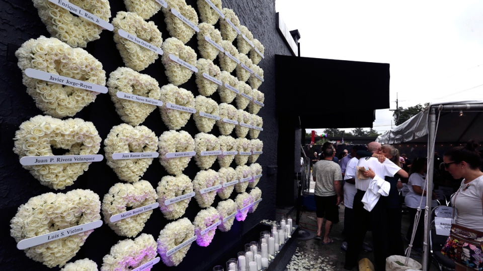 A wall of flowered-hearts on the side of the Pulse nightclub, on June 12, 2017. (Joe Burbank /Orlando Sentinel via AP)