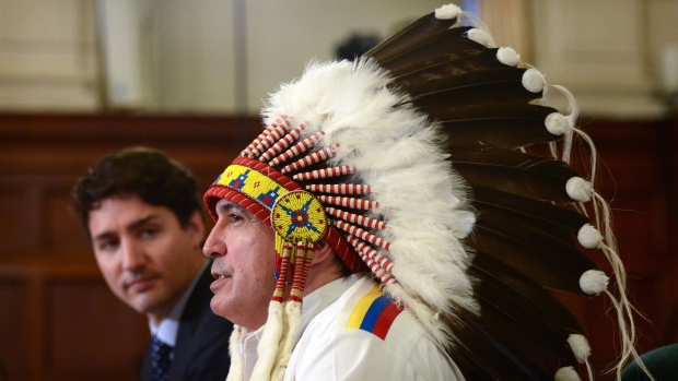 Prime Minister Justin Trudeau and Assembly of First Nations Chief Perry Bellegarde participates in the signing of the Assembly of First Nations-Canada Memorandum of Understanding on Joint Priorities on Parliament Hill in Ottawa on Monday, June 12, 2017. THE CANADIAN PRESS/Sean Kilpatrick