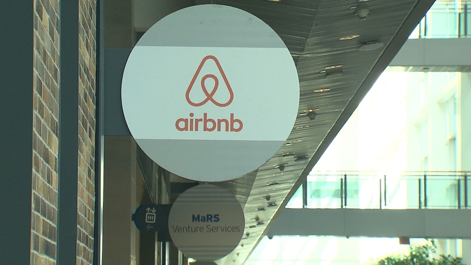 The Airbnb logo hangs outside the company's Toronto office space.