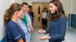 Kate, Duchess of Cambridge talks with hospital staff at King's College Hospital in London, Monday June 12, 2017, to meet staff and patients who were affected by the attacks in London Bridge and Borough Market on June 3. (Dominic Lipinski/Pool via AP)