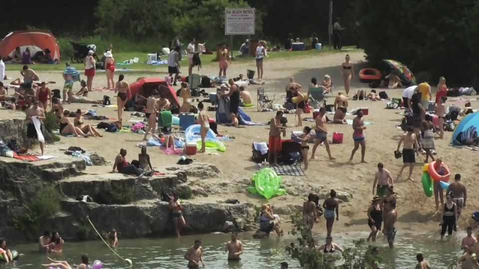 People enjoy the beach at the Elora Quarry on Monday, June 12, 2017.