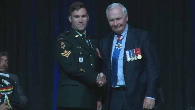 Master Cpl. Kyle Button receives a medal for military merit in his response to the October 2014 shootings at Parliament Hill in Ottawa.