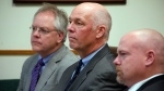 Congressman-elect Greg Gianforte, centre, sits alongside William Mercer, left, and Todd Whipple during his court hearing in Bozeman, Mont., on Monday, June 12, 2017. (Freddy Monares/Bozeman Daily Chronicle via AP)