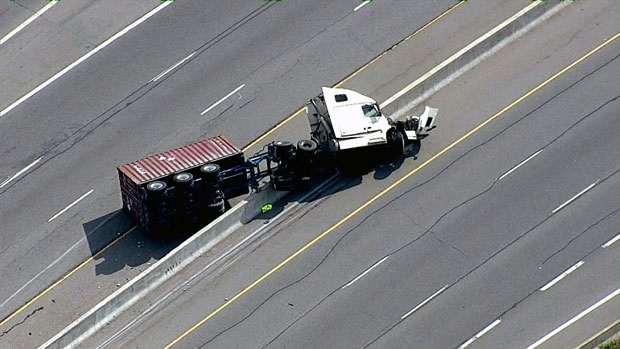 The QEW has been shut  down in St. Catharines after a tractor trailer flipped over.
