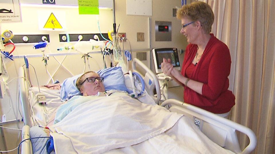 Dr. Alison Fox-Robichaud checks in with sepsis patient Krista Messier.