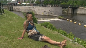 Jessica Sallay-Carrington was relaxing in Jeanne Mance park, not wearing a top, when she was threatened with a $1,000 fine