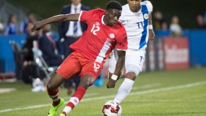 Canada's Alphonso Davies clears the ball away from Curacao's Gevaro Nepomuceno during second half of a friendly match, in Montreal on Tuesday, June 13, 2017. (THE CANADIAN PRESS / Paul Chiasson)