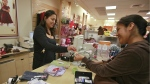 Susi Ortiz, right, buys children's clothing at the Gymboree store at the Westside Pavilion Shopping Center in Los Angeles on Monday, Oct. 4, 2010. (AP / Damian Dovarganes)