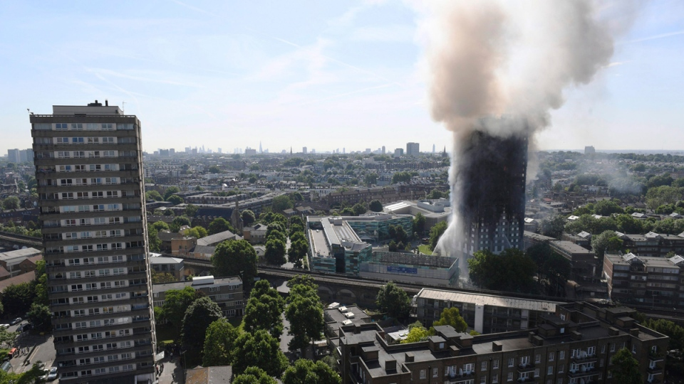 Smoke billows from a fire that engulfed the 24-storey Grenfell Tower in west London, on June 14, 2017. (Victoria Jones / PA via AP)