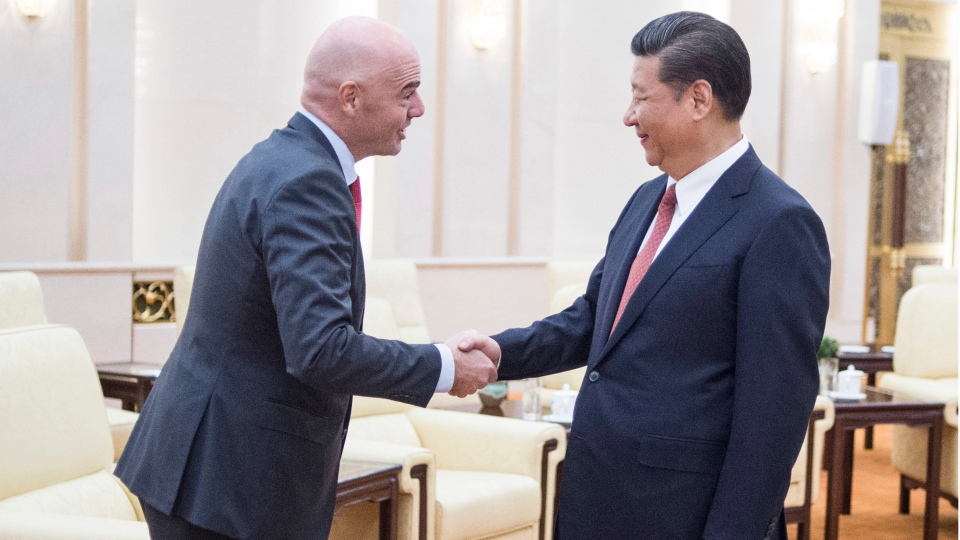 FIFA President Gianni Infantino, left, shakes hands with China's President Xi Jinping at the Great Hall of the People in Beijing on Wednesday, June 14, 2017. (Fred Dufour/Pool Photo via AP)