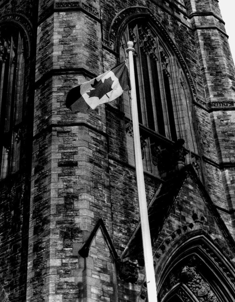 The Maple Leaf flag flies in front of the Peace Tower on Parliament hill in Ottawa Feb. 15, 1965. It was officially raised at 12 noon EST. (CP PHOTO/ file)